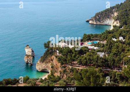Picturesque islets Faraglioni di Puglia in summer Adriatic sea bay Baia Delle Zagare (Mattinata, Gargano peninsula, - Stock Photo