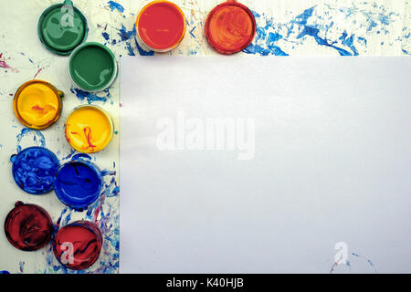 Painting equipment with copy space on white paper texture for Presentations with paint pallete bright color - Stock Photo