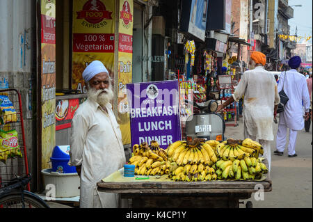 Amritsar, India - Jul 25, 2015. A vendor selling banana in Amritsar, India. Amritsar is home to the Harmandir Sahib, - Stock Photo