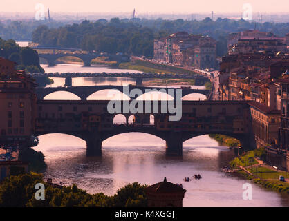 Florence, Florence Province, Tuscany, Italy.  View to bridges across Arno river.  Ponte Vecchio in foreground.  - Stock Photo