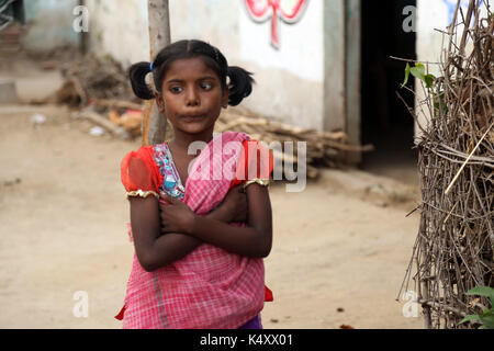 Unidentified Happy Indian rural school girl at their Village India. - Stock Photo