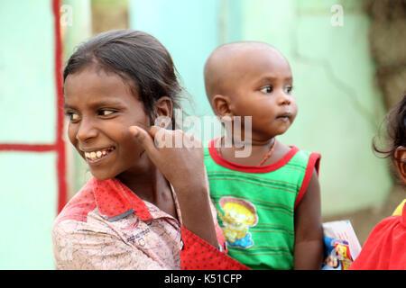Unidentified children in rural village at india - Stock Photo