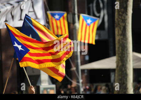 Barcelona, Spain. 11th Sep, 2017. People participating with Catalan independentist symbols at the Diada, the national - Stock Photo