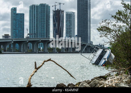 Miami, USA. 11th Sep, 2017. A view of a boat at the shore of Venetian Island after hurricane Irma in Miami, Florida, - Stock Photo
