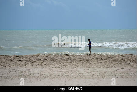 Miami, USA. 11th Sep, 2017. A man stands at a beach after Hurricane Irma swept through the area, in Miami, Florida, - Stock Photo