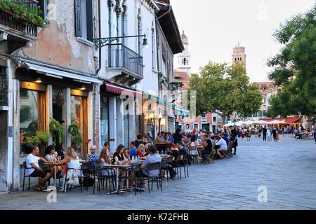 Restaurants at Campo Santa Margherita square: Bollicine and Osteria alla Bifora - Stock Photo