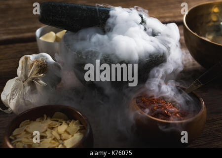 Various type of spices in bowl on wooden table - Stock Photo