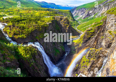 Waterfall Voringfossen and panorama view over the plateau and canyon of Mabodalen, Norway, Scandinavia - Stock Photo