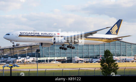 A Boeing 777 widebody airliner of Singapore Airlines approaching London Heathrow Airport's runway 09L. - Stock Photo
