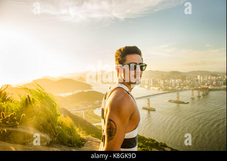 Man at view point during sunset, Rio de Janeiro, Brazil - Stock Photo