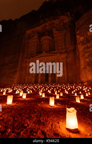 Exterior view of the rock caves and architecture of the facade in sandstone at Al Khazneh or The Treasury at Petra, - Stock Photo