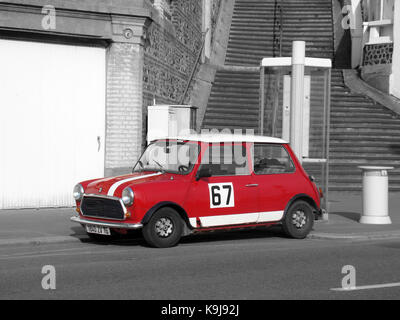 classic car an austin mini parked in the high street of the quaint stock photo royalty free. Black Bedroom Furniture Sets. Home Design Ideas