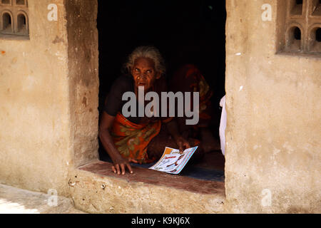Unidentified Indian Old Woman lives house - Stock Photo