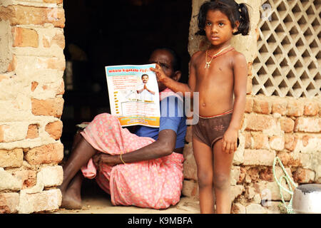 Unidentified Happy Indian rural child front of their house in village - Stock Photo