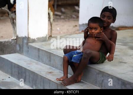 Happy Indian rural children smile - Stock Photo