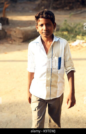 Portrait of unidentified Indian boy on the street - Stock Photo