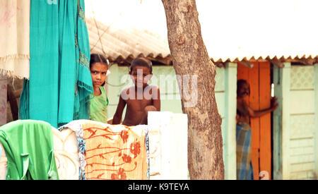 Unidentified children in rural village - Stock Photo