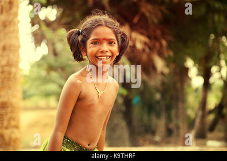 Unidentified Happy Indian rural girl front of their house in village, - Stock Photo