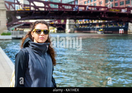 Female traveler exploring streets of Chicago, USA - Stock Photo