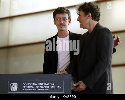 San Sebastian, Spain. 25th Sep, 2017. French film director Albert Dupontel (R) and Argentinian actor Nahuel Perez - Stock Photo