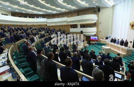 MOSCOW, RUSSIA - SEPTEMBER 27, 2017: Russian Federation Council members listening to the Russian national anthem - Stock Photo