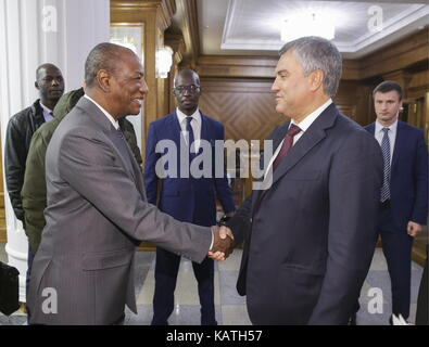 MOSCOW, RUSSIA - SEPTEMBER 27, 2017: Alpha Conde (L), President of the Republic of Guinea, shakes hands with Russian - Stock Photo