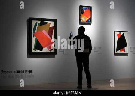 MOSCOW, RUSSIA - SEPTEMBER 27, 2017: A visitor looks at works by painter Liubov Popova 'Painterly Architectonic' - Stock Photo