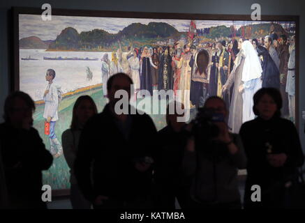 MOSCOW, RUSSIA - SEPTEMBER 27, 2017: Visitors look at a painting by Mikhail Nesterov 'Rus: The Soul of the People' - Stock Photo