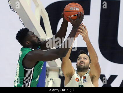 MOSCOW, RUSSIA - SEPTEMBER 27, 2017: Darussafaka S.K. Istanbul's Micheal Eric (L) and Panathinaikos' Ian Vougioukas - Stock Photo