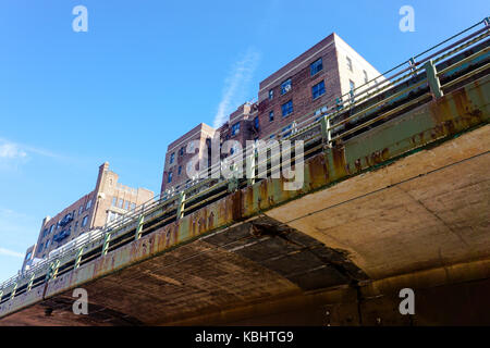 Under bridge in Brooklyn near the the hudson river, blue sky and buildings New york - Stock Photo