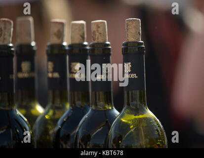 Crimea, Russia. 30th Sep, 2017. Bottles of wine at the WineFest grape harvesting and wine making festival at the - Stock Photo