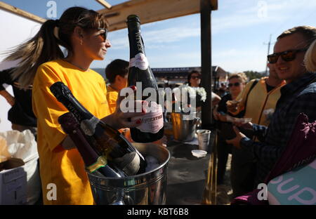Crimea, Russia. 30th Sep, 2017. People attend the WineFest grape harvesting and wine making festival at the Zolotaya - Stock Photo