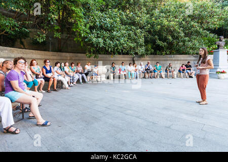 LIVADIYA, CRIMEA - SEPTEMBER 21, 2017: tourists listen to the guide in front of Livadia Palace entrance. The palace - Stock Photo