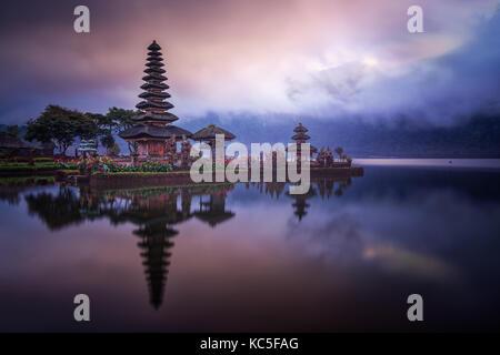 Cloudy sunrise  in the Hindu water temple Ulun Danu Bratan also known as Pura Bratan, in the Indonesian island of - Stock Photo