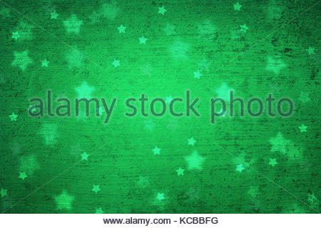 Grunge magical blurry star shape abstract Christmas and New Year Holidays copy space on green background. Lovely - Stock Photo