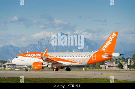 An Easyjet Airbus A320-214 taxiing at Milan's Linate Airport. The airplane is decorated to celebrate Easyjet's 20 - Stock Photo