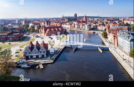 Gdansk, Poland. Aerial skyline panorama with Motlawa river, modern drawbridge, concert hall and all famous monuments - Stock Photo