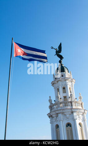 Cuban flag flies atop the ornate tower of the Gran Teatro de La Habana Alicia Alonso, Havana, Cuba - Stock Photo