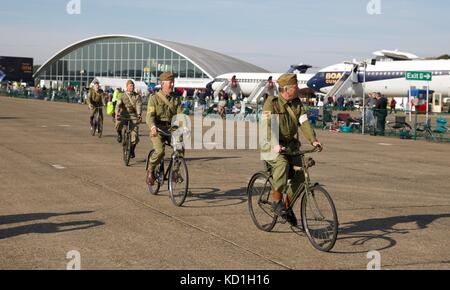 Re-enactment of the Home Guard cycling at the 2017 Battle of Britain Air Show at IWM Duxford - Stock Photo