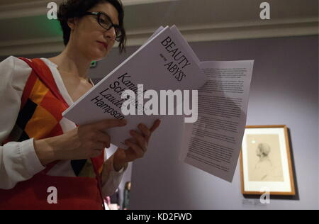 Moscow, Russia. 9th Oct, 2017. A girl looks through a brochure as she attends an exhibition of drawings by Austrian - Stock Photo