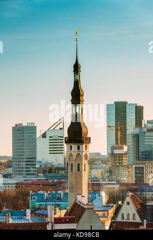 Tallinn, Estonia - December 4, 2016: Tower Of Tallinn Town Hall On Background Of Modern Architecture. Oldest Town - Stock Photo