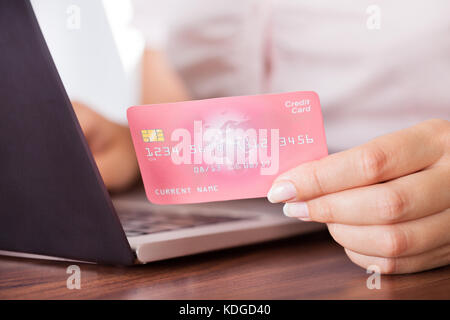 female electronic payment close up cell phone hand shop electronic stock photo 68898204 alamy. Black Bedroom Furniture Sets. Home Design Ideas
