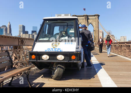 A man on his three wheeled scooter stock photo 21412529 for Motor vehicle in brooklyn