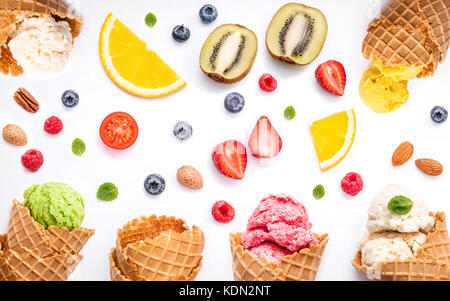 Colorful ice cream with cones and various fruits raspberry ,blueberry ,strawberry  and peppermint leaves setup on - Stock Photo