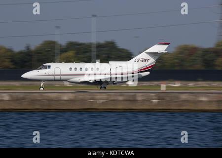 Raytheon Hawker 850XP Landing at London City Airport - Stock Photo