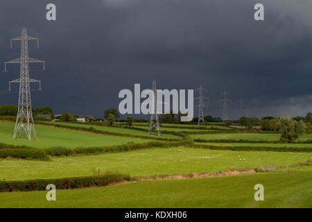 Overhead electricity power-lines and pylons in County Armagh, Northern Ireland. - Stock Photo