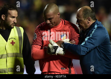Nicosia, Cyprus. 17th Oct, 2017. Nicosia's keeper Boy Waterman (C) leaves the field after suffering an injury during - Stock Photo