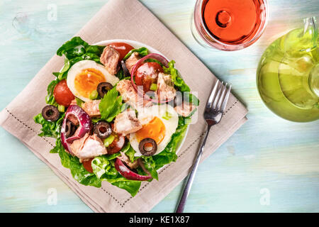 Tuna salad with wine, olive oil, and copy space - Stock Photo