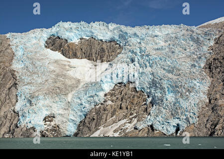 Blue Ice on a Sunny Day on the Northwestern Glacier in Kenai Fjords National Park - Stock Photo
