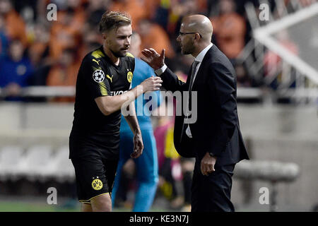 Nicosia, Cyprus. 17th Oct, 2017. After being switched out, Dortmund's Marcel Schmelzer passes his coach Peter Bosz - Stock Photo